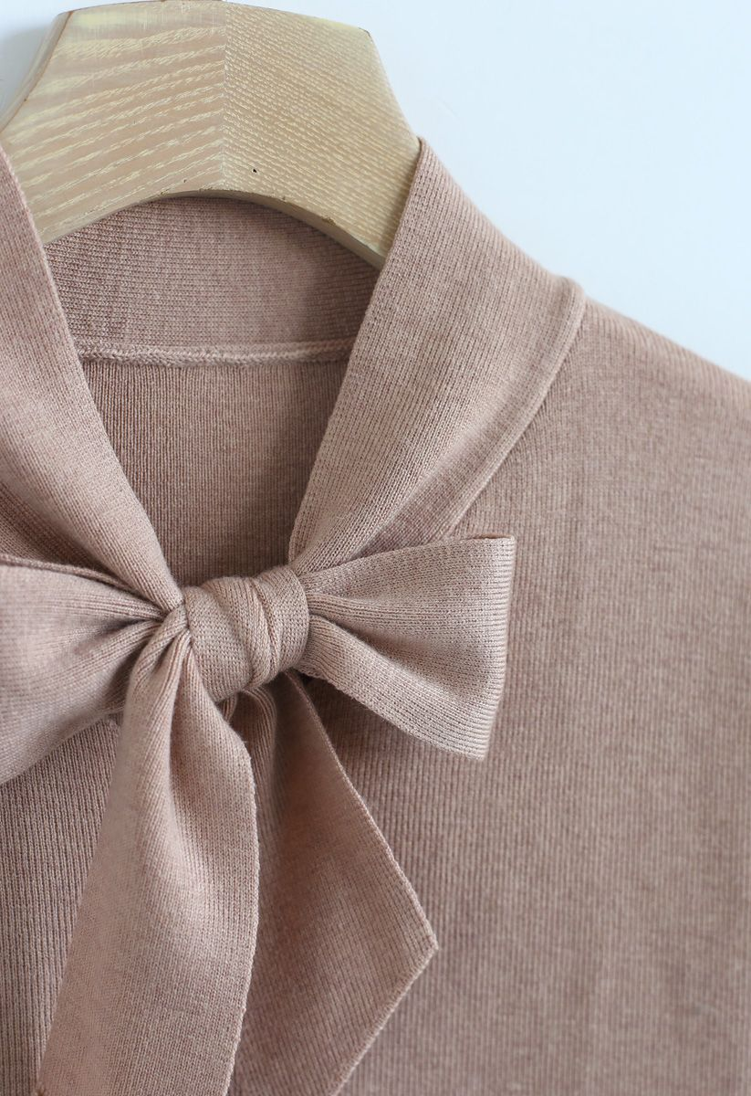 Top en maille avec manches à nœud dans le beige