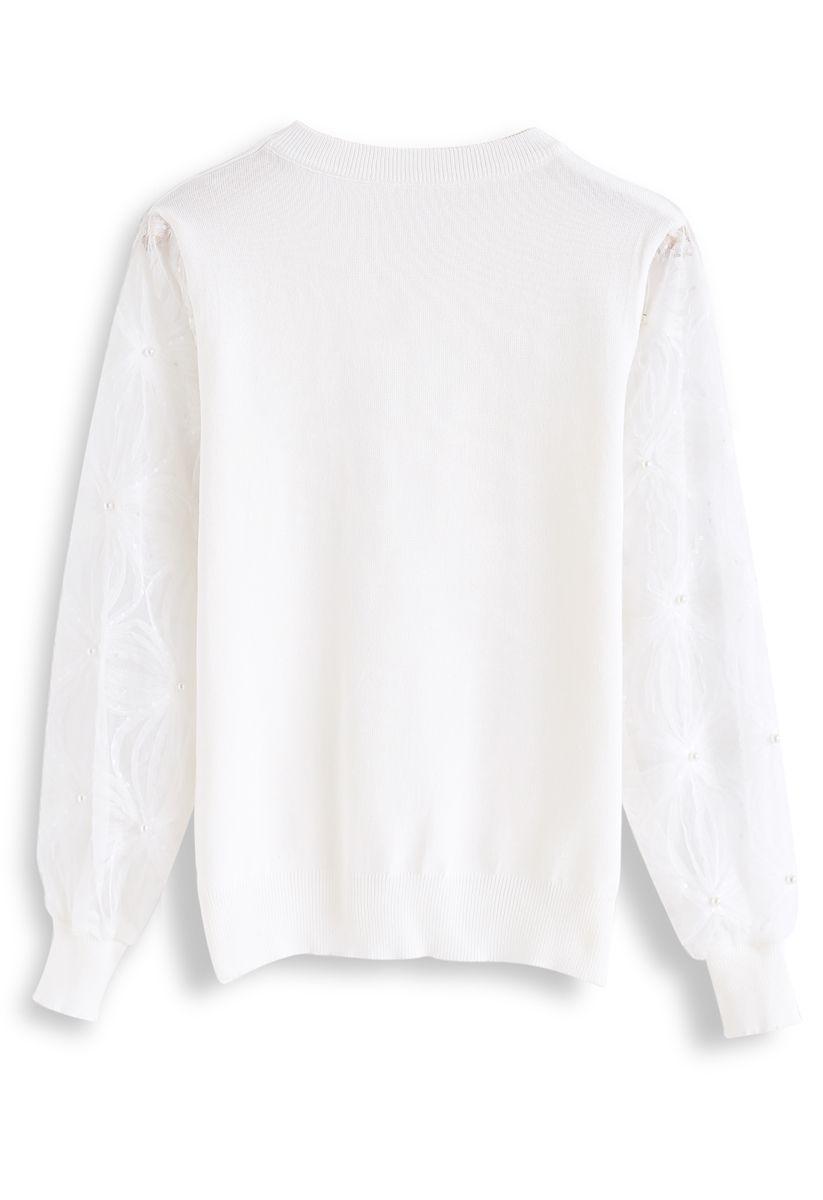 Haut en maille avec manches en filet et perles et sequins en blanc