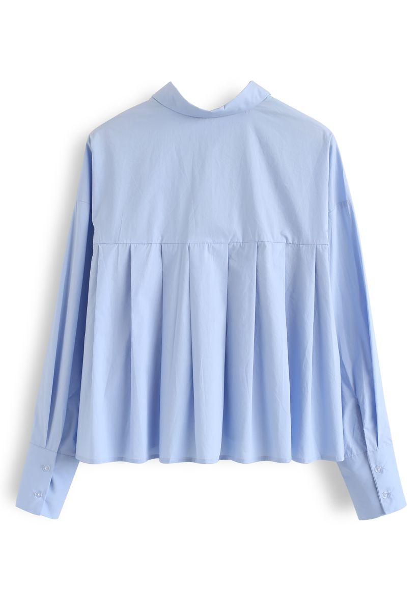 Chemise courte à manches boutonnées en bleu