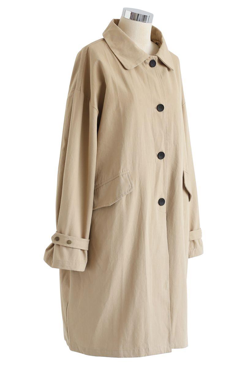 Manteau boutonné à col pointu en beige clair