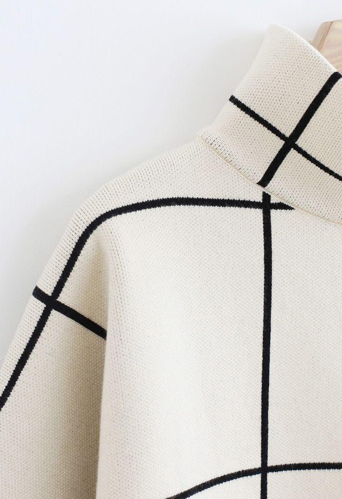 Pull à col roulé blanc motif grille