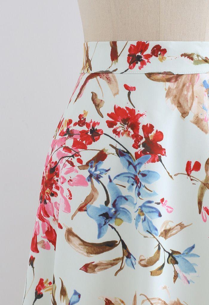 Superbe jupe mi-longue trapèze à imprimé floral en rose