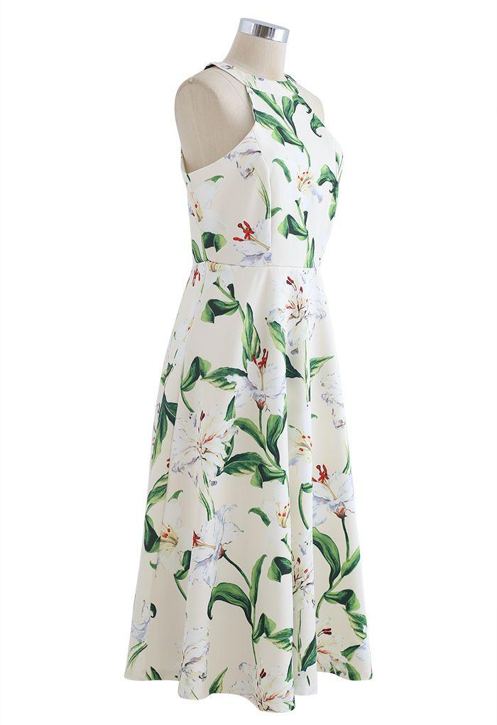 Superbe robe mi-longue à imprimé floral et licou en vert
