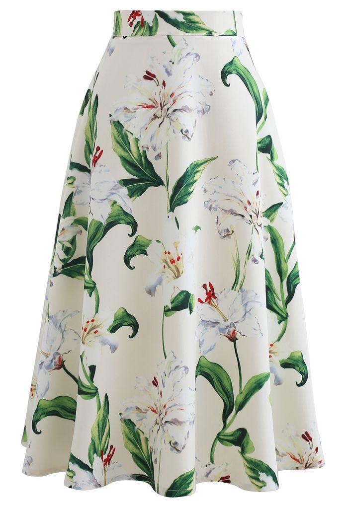 Superbe jupe mi-longue trapèze à imprimé floral en vert