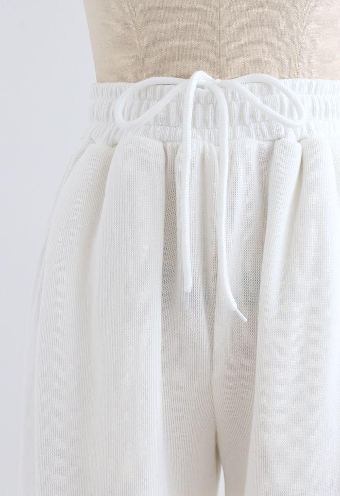 Pantalon de jogging avec cordon de serrage et poche plaquée cœur en blanc