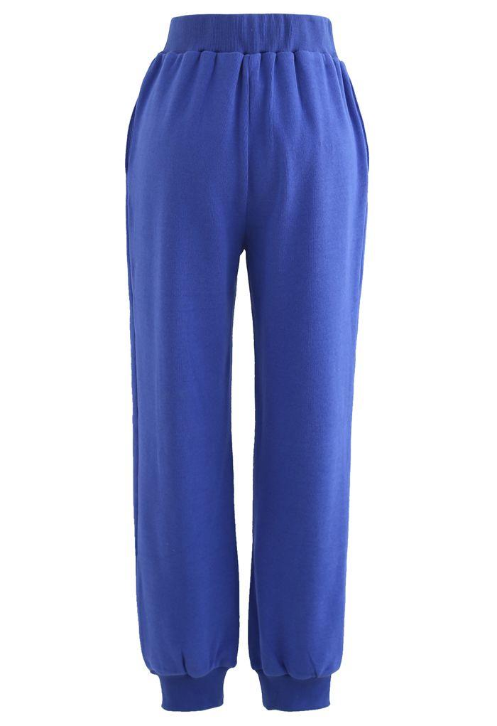 Pantalon de jogging zippé avec poches latérales sur le devant en bleu