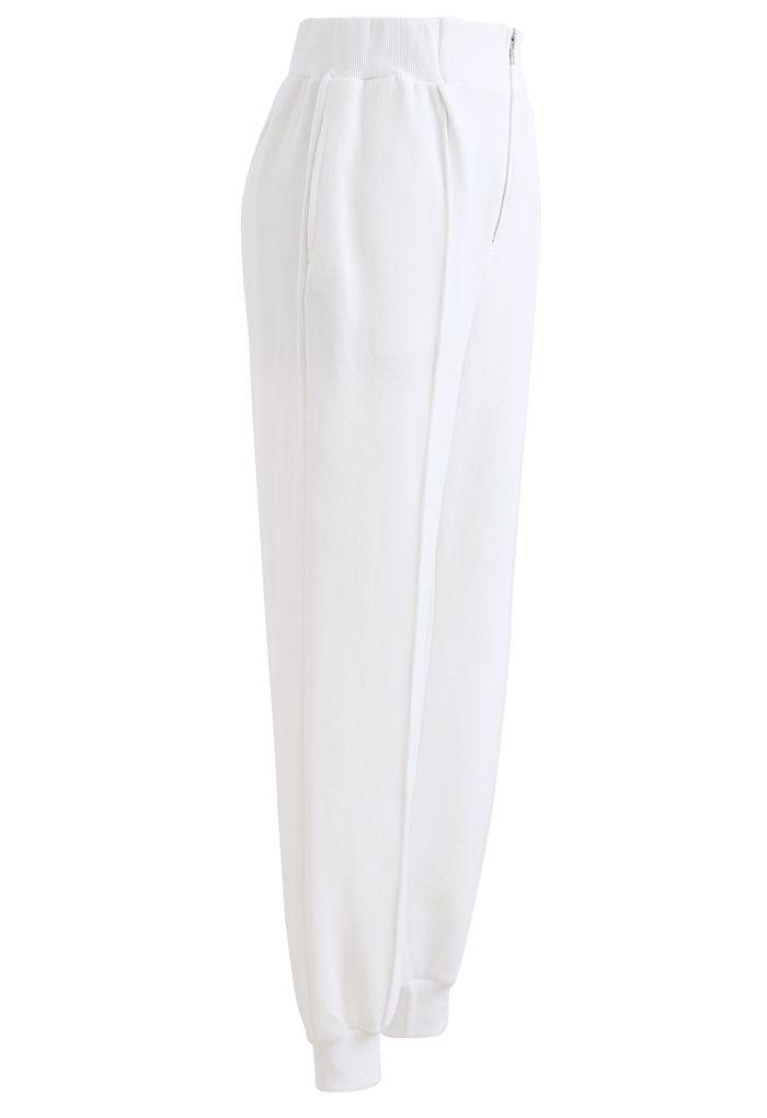 Pantalon de jogging zippé avec poches latérales sur le devant en blanc