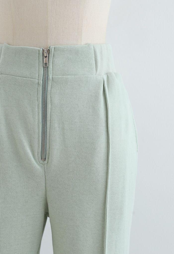 Pantalon de jogging zippé avec poche latérale sur le devant en vert