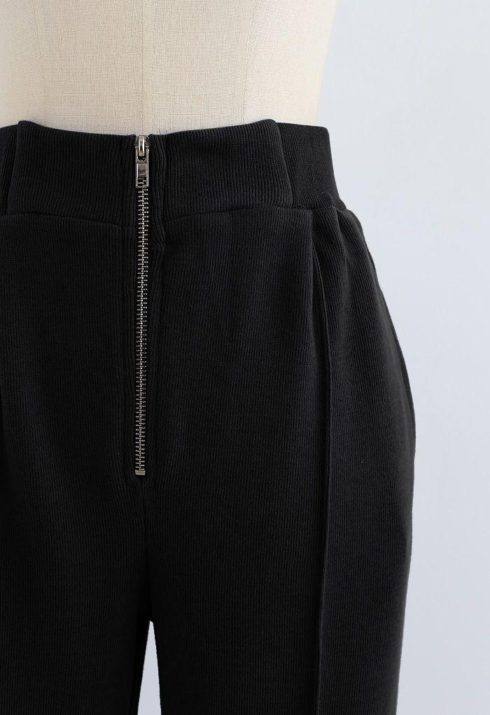 Pantalon de jogging zippé avec poche latérale sur le devant en noir
