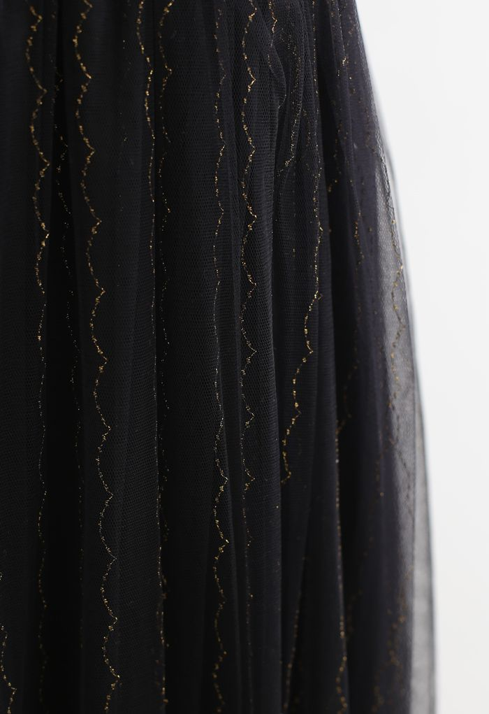 Robe camisole en maille dorée festonnée en noir