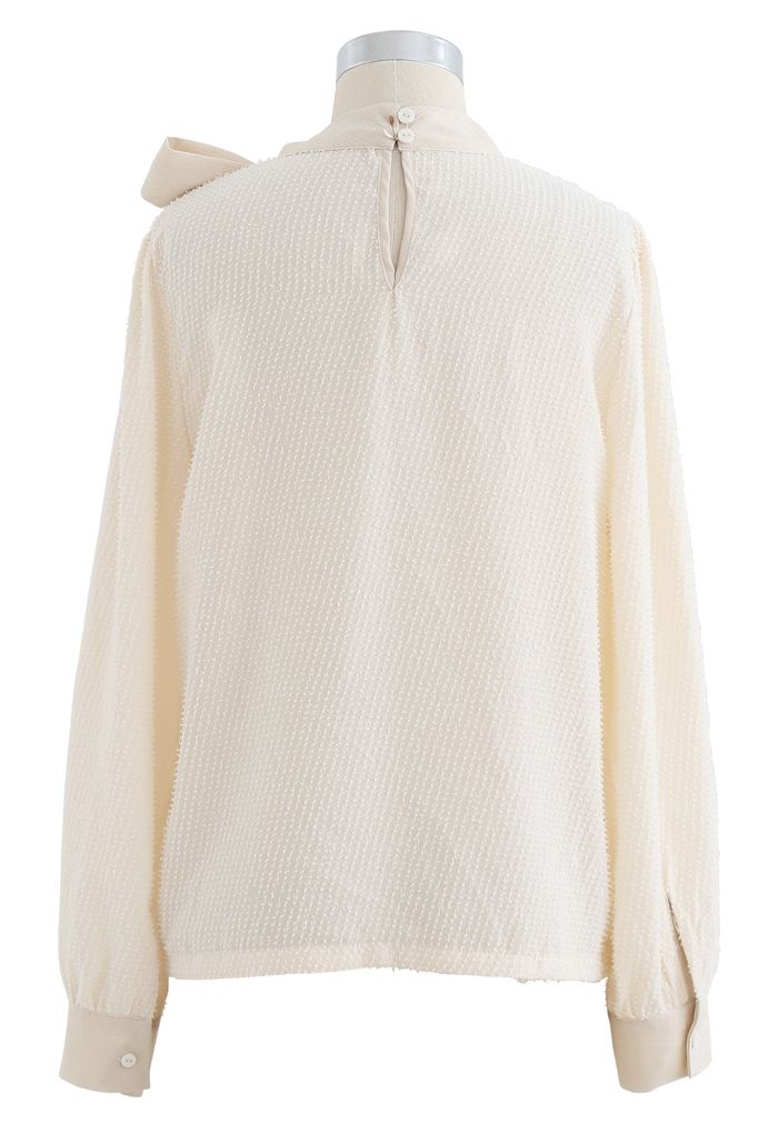 Tie a Bow Shimmer Tasseled Top in Cream