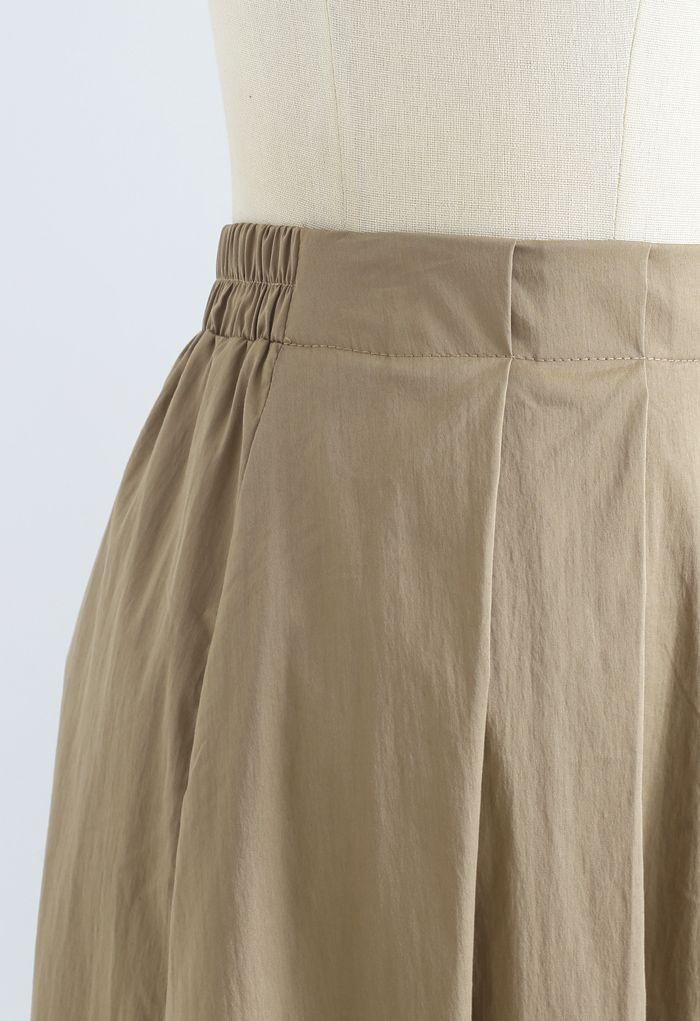 Jupe mi-longue plissée trapèze en coton kaki