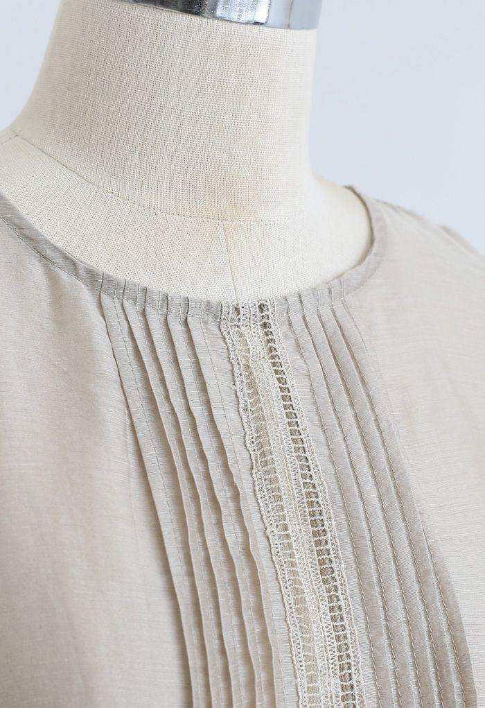 Chemise décorée de nervures à manches bouffantes