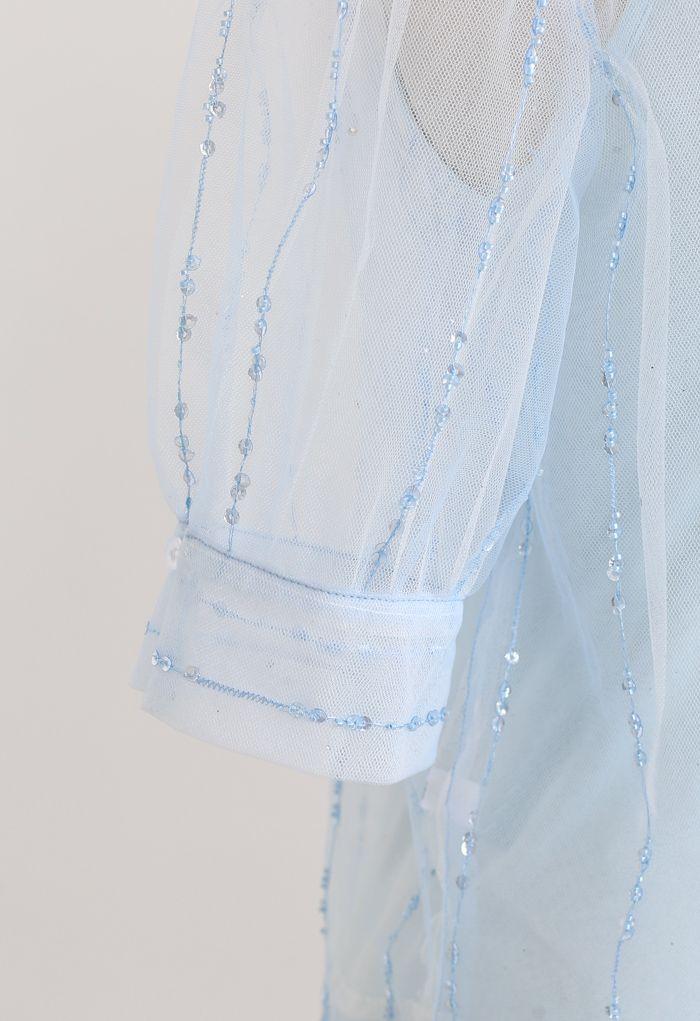 Top en maille pailletée à col claudine et dos noué en bleu