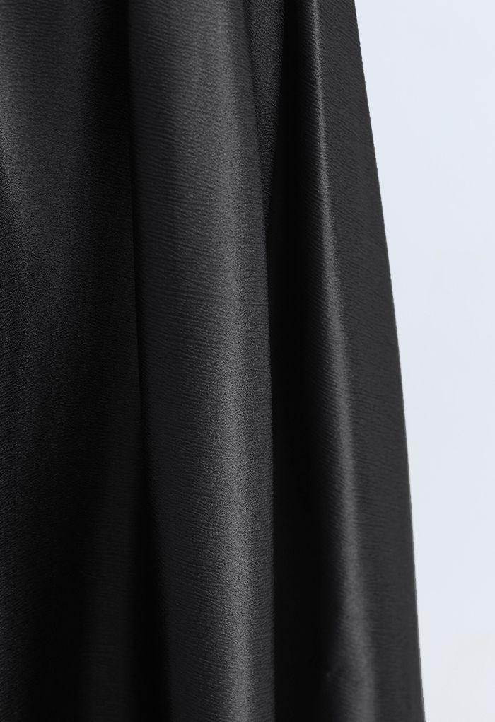 Jupe longue évasée à texture ceinturée en noir
