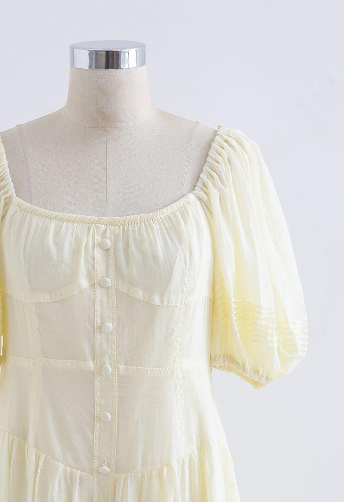 Robe fluide à volants boutonnée et manches bouffantes en jaune clair