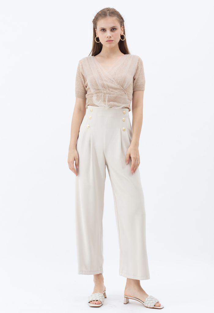 Pantalon plissé orné de boutons en ivoire