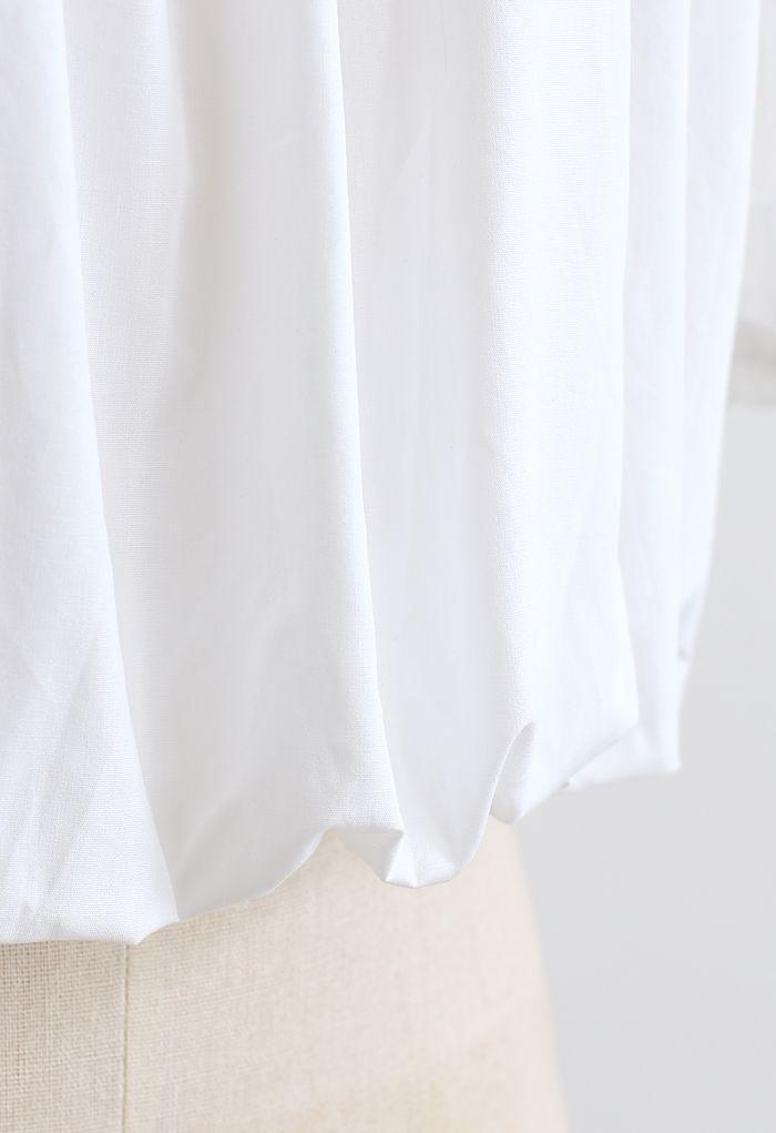 Crop top à épaules dénudées et manches bulle en blanc