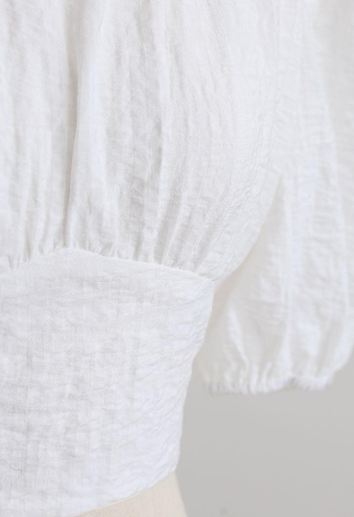 Crop top à carreaux en jacquard à encolure en V et taille en blanc