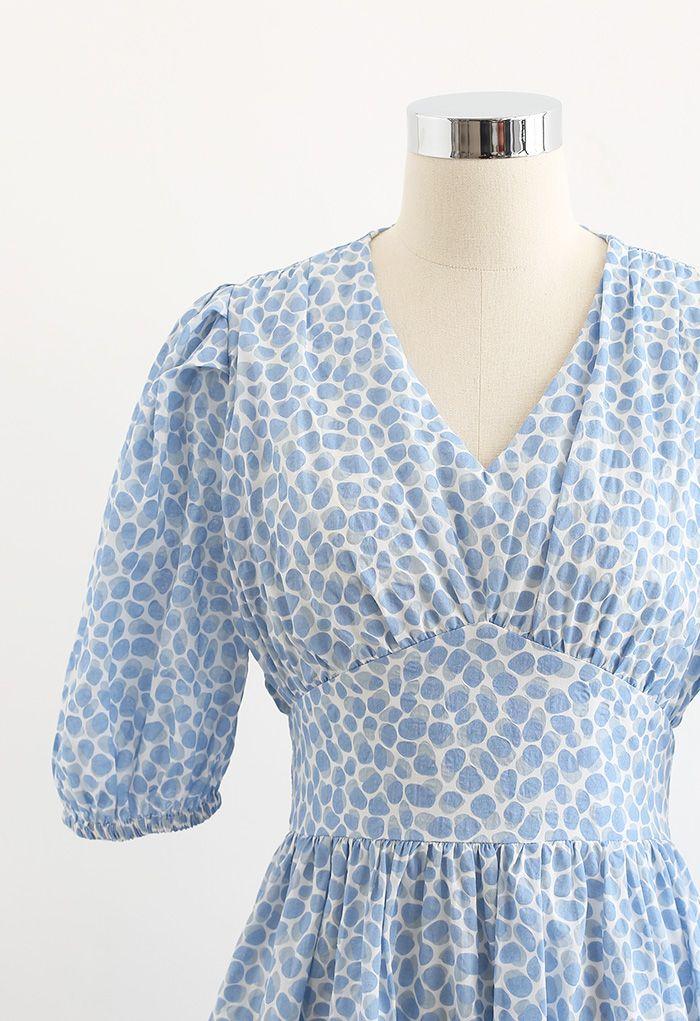 Robe mi-longue nouée à imprimé bulle en bleu