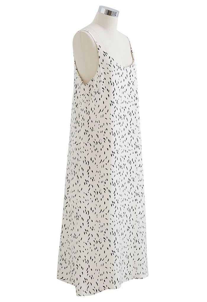 Robe camisole à col en V à pois en ivoire