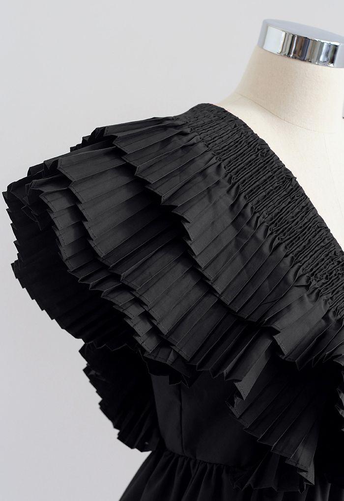 Crop top plissé à col en V profond boutonné à volants en noir