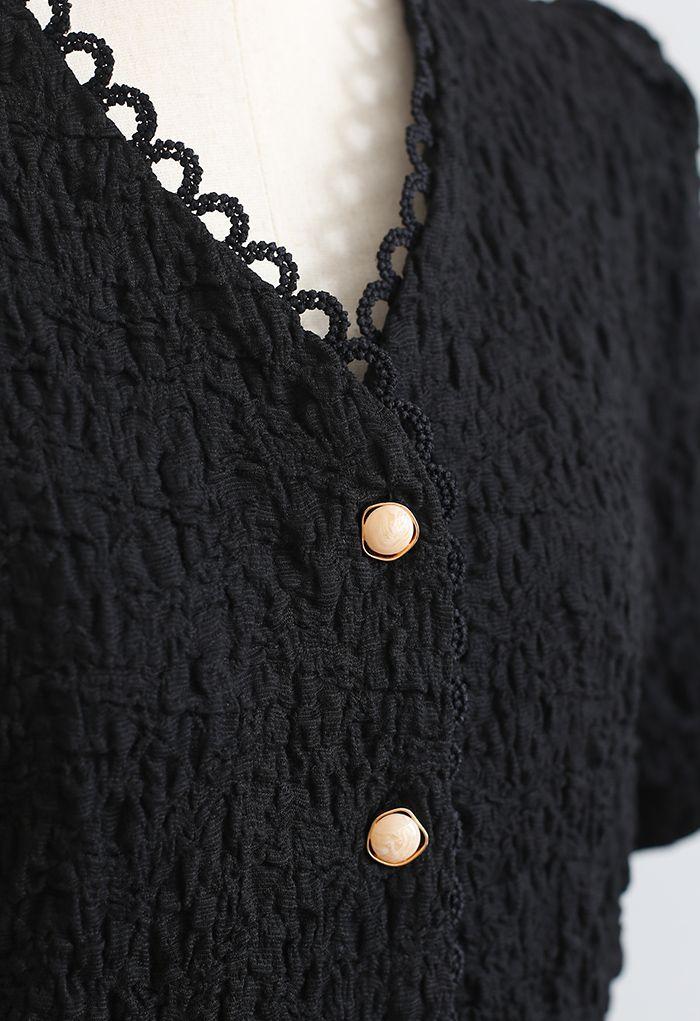 Haut boutonné à col en V en relief sur le devant en noir