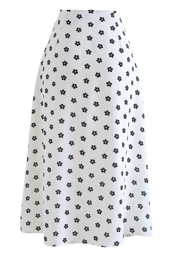 Jupe mi-longue trapèze à taille haute et imprimé marguerite en blanc
