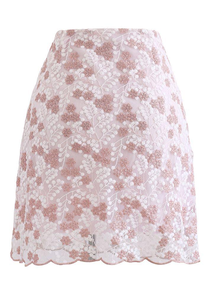 Mini-jupe en maille fleurie brodée