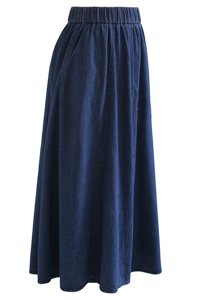 Jupe mi-longue en jean avec fente sur le devant et poche latérale en bleu marine