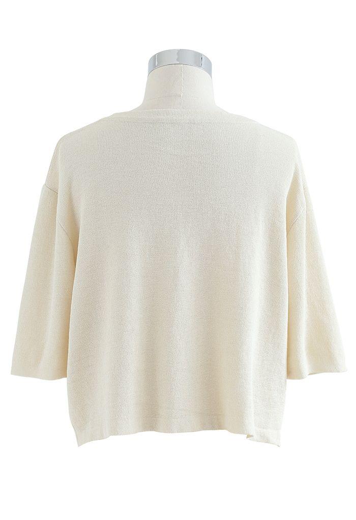 Top court en tricot côtelé à col rond en crème