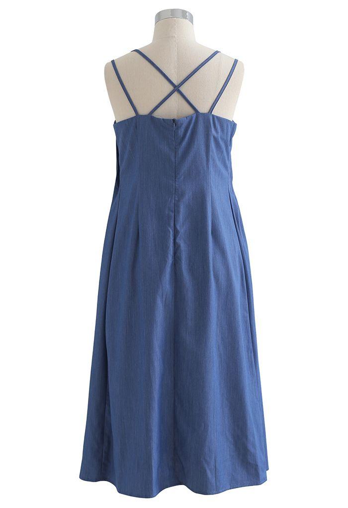 Robe caraco à dos croisé et plissée sur le devant en bleu