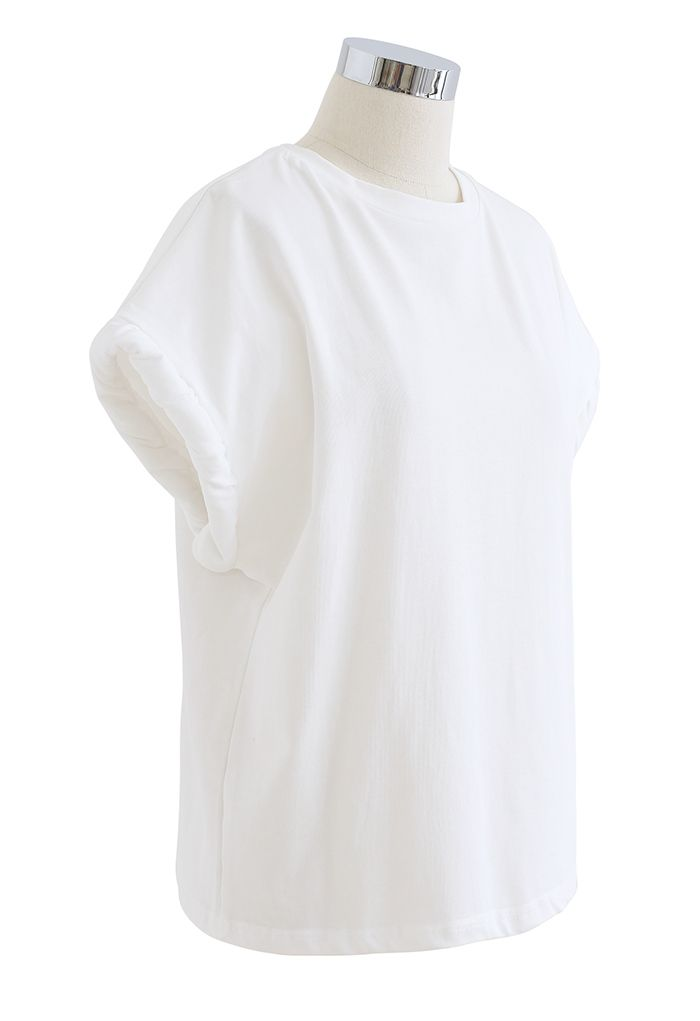 Haut oversize matelassé à poignets torsadés en blanc