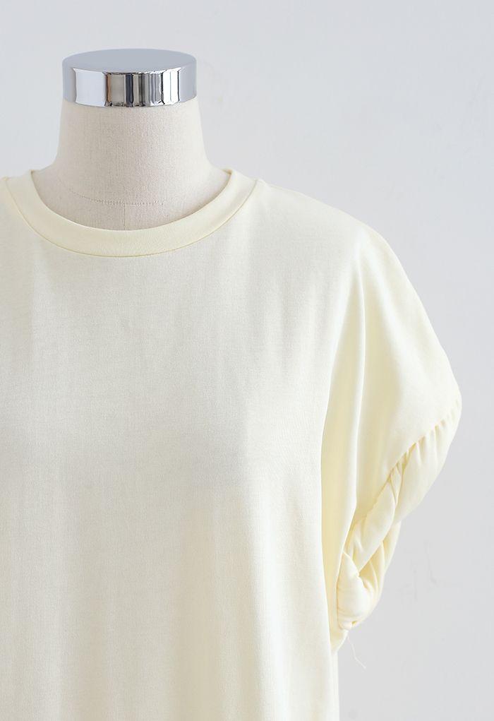 Haut oversize matelassé à poignets torsadés en jaune clair