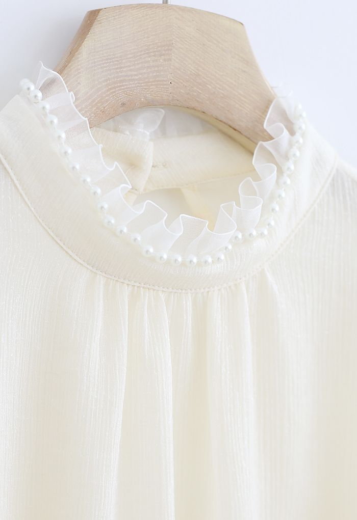 Glittery Ruffle Neck Pearls Trim Top in Ivory