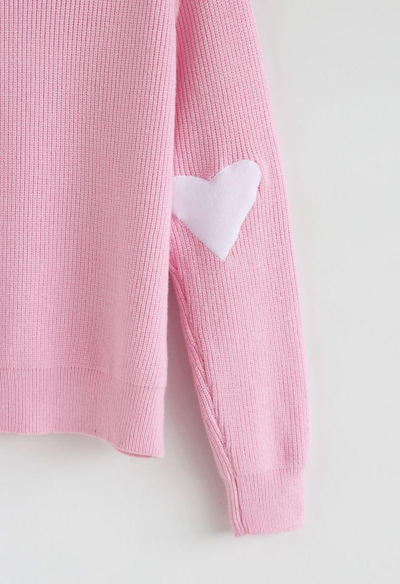 Pull en maille à pois et cœur en rose