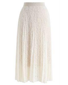 Jupe mi-longue plissée à pompon en crème