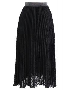 Jupe mi-longue plissée à pampilles en noir
