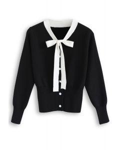 Pull en tricot boutonné avec nœud papillon en noir