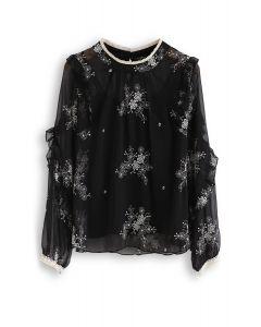 Haut semi-transparent brodé à œillets et fleurs en noir