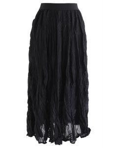 Jupe midi plissée brodée en biais en noir