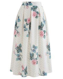 Jupe mi-longue plissée brodée à œillets à imprimé rose