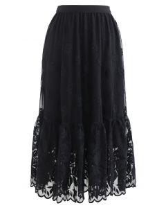 Jupe mi-longue en organza à fleurs brodées en noir