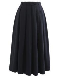 Jupe mi-longue plissée trapèze en coton noir
