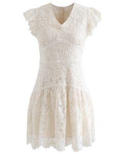 Mini-robe sans manches à fleurs brodées en crème