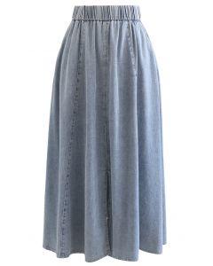 Jupe mi-longue en jean avec fente sur le devant et poche latérale en bleu délavé