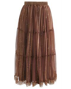 Jupe en maille velours et perles sautillantes en brun
