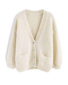Pause pour le confortable cardigan en tricot à la main Chunky à la crème
