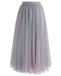 Adorable jupe mi-longue en tulle à mailles en gris
