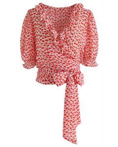 Attachez un haut gainé de fleurs bowknot en rouge